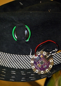 The LilyPad Arduino exposed.
